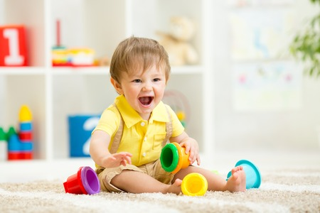 kid child girl playing on floor at home or kindergarten Stock Photo