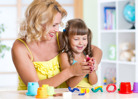 playdoh: Child and mother playing with colorful clay