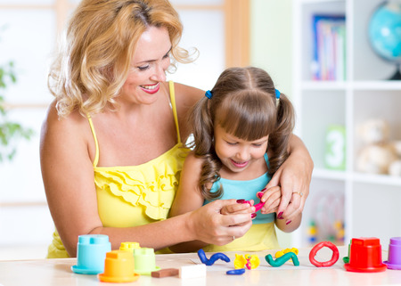 playdoh: mother and daughter have a fun playing with clay