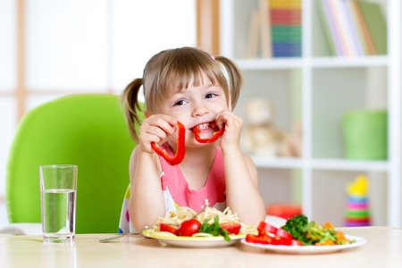 healthy girl: child eating healthy food in kindergarten or at home Stock Photo