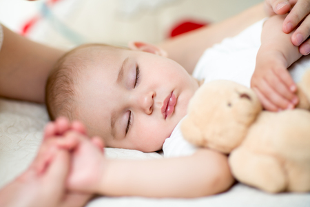 sleeping rooms: sleeping cute baby boy with plush toy Stock Photo