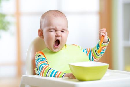 funny kid boy eating healthy food indoors Foto de archivo