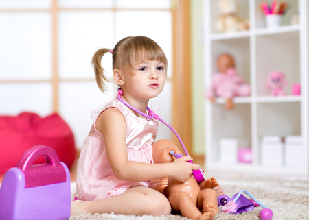 baby playing: Little girl playing with baby dolls in hospital