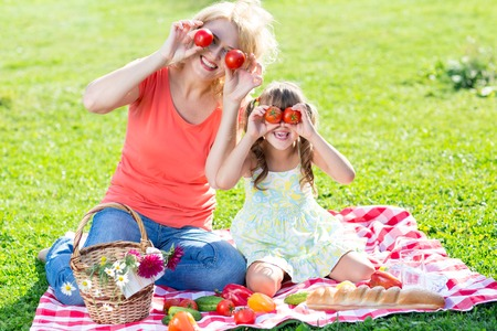 picnicking: Family having fun while picnicking in summer park