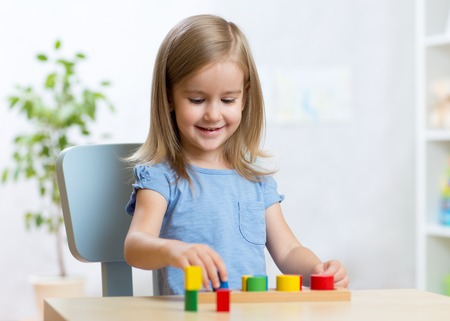 kids toys: little child girl playing with educational toys