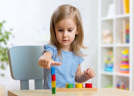 little girl child kid playing with building blocks