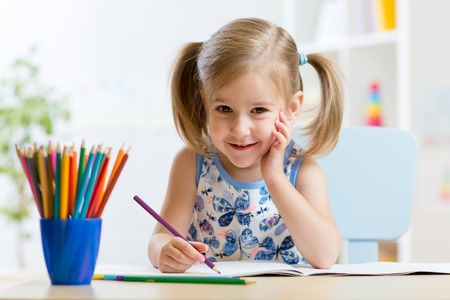 little table: Cute little girl child kid drawing at home