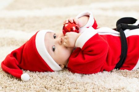 cute baby boy: Baby boy weared Santa costume hollding christmas ball