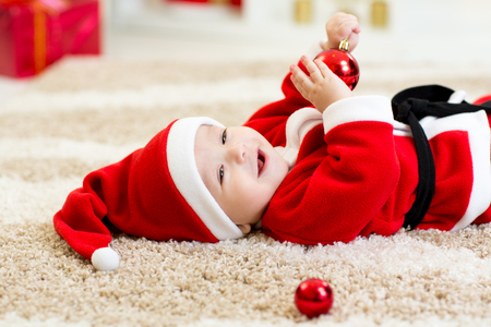 christmas costume: Baby boy weared Santa costume hollding christmas ball