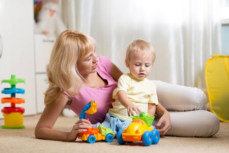 indoor: mother with her son child play together at home