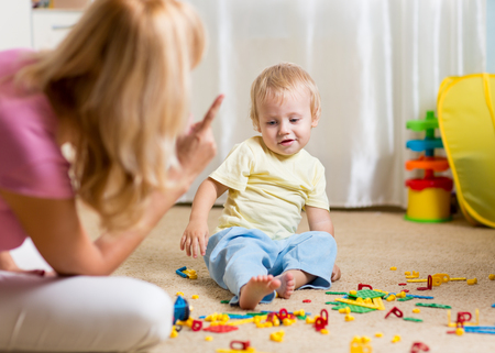 chaos: Mother berating her little child son in jest at home