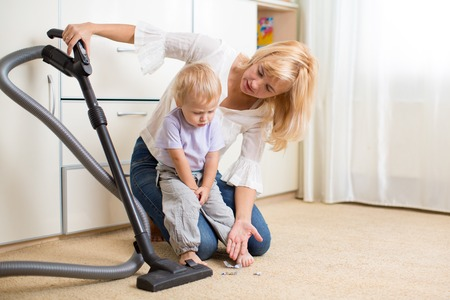 hoover: Mother teaches her child son room cleaning with vacuun cleaner