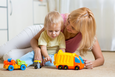 toddler boy: happy mother and child toddler boy playing together at home Stock Photo