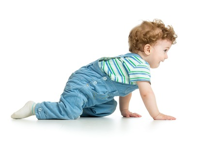 crawling baby toddler isolated on white background Archivio Fotografico