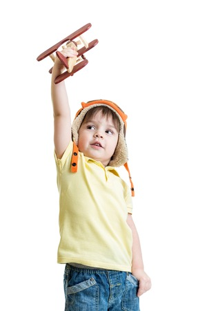 kids hand: happy kid boy with airplane toy dreams to be pilot