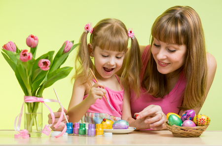 happy mother and child daughter to decorate Easter eggs photo