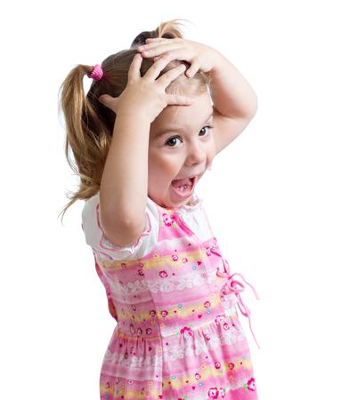 surprised kid: Amazed or surprised child kid hands holding head Stock Photo