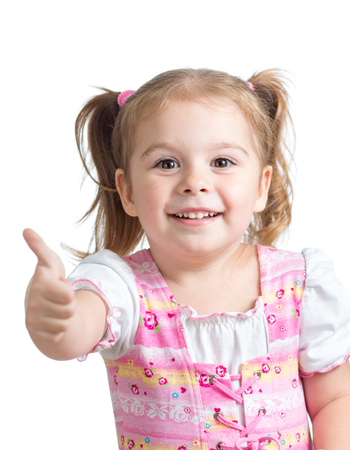 Portrait of a beautiful child girl showing thumbs up isolated on white photo