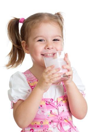 Child Girl drinking Milk or yogurt from glass photo