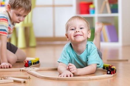 playschool: Children playing rail road toy in nursery