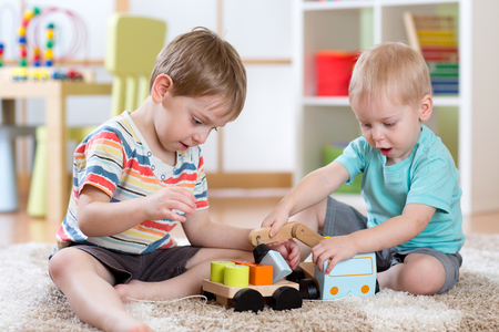 kids playing: Kids playing car toy in nursery or daycare