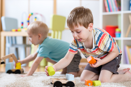 Children playing with toys in kindergarten or daycare