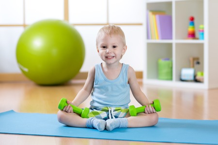 Smiling  funny child boy ready to fitness exercises photo
