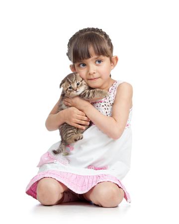little girl hugging kitten. isolated on white background