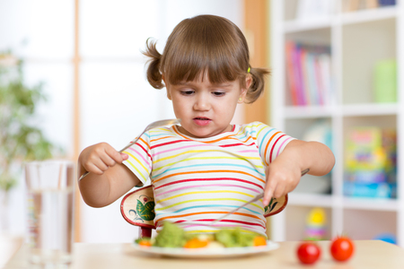no food: Little child girl refusing to eat her dinner or lunch