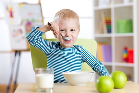 kid eating healthy food at home or daycare photo