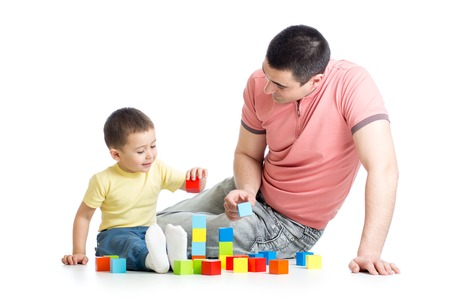 Father and child playing game together over white background 写真素材