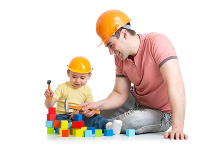 dad son: Child and his dad playing game together over white background
