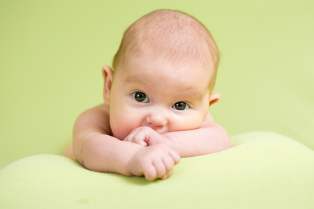 Baby newborn infant kid lying on belly