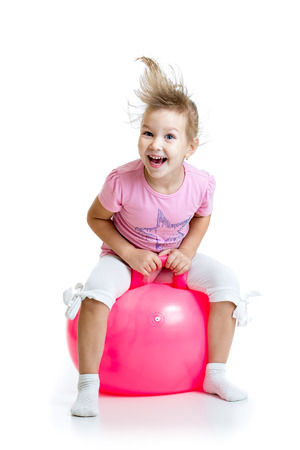 child ball: happy child jumping on bouncing ball. Isolated on white.