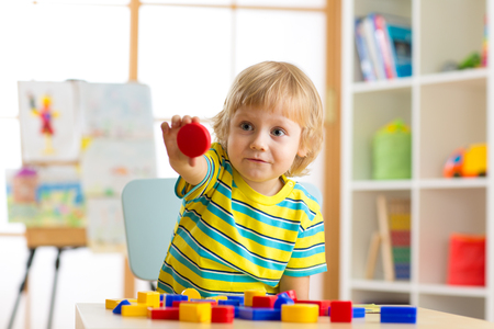 Child little boy learning shapes, early education and daycare concept Stock Photo