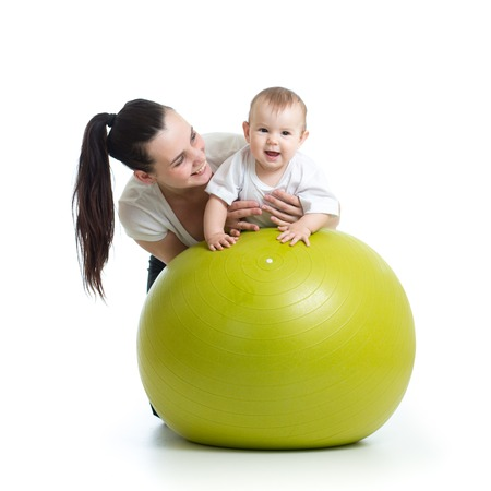 big ball: young mother and her baby child doing yoga exercises on gymnastic ball isolated over white
