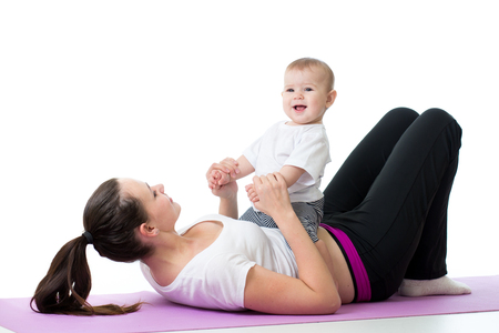Mother with child boy doing fitness exercises photo