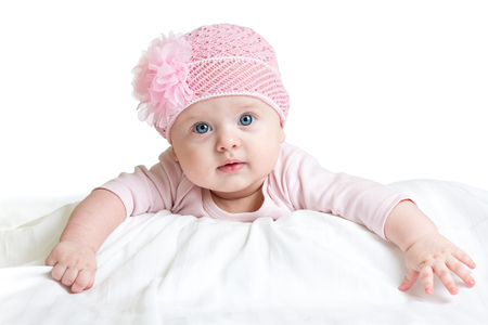 three months old: Portrait of three months old adorable baby girl wearing pink hat
