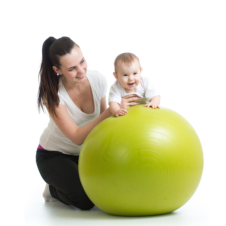 kid and mother with fitness ball isolated photo