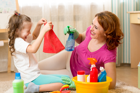 mother with kid cleaning room and having fun Stock Photo