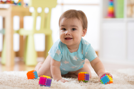 crawling funny baby boy indoors at home Reklamní fotografie