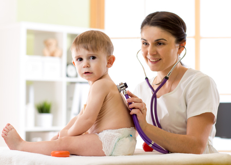 pediatrist: child medical examination with stethoscope in hospital
