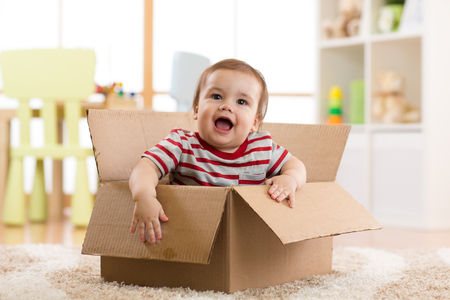 pretty baby: pretty baby inside a box Stock Photo