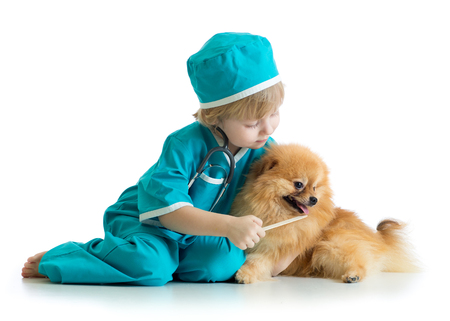 Kid weared doctor clothes playing veterinarian
