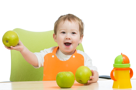 littlle boy with green apples, isolated on white photo