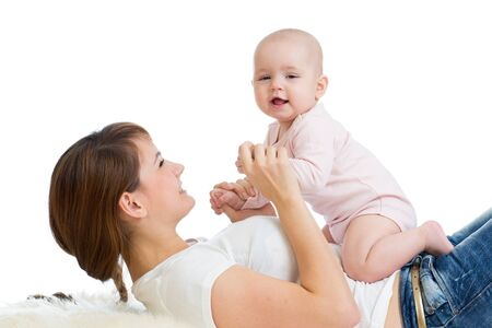 Positive baby and mom. Young mother plays with her little daughter. photo