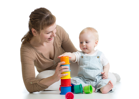 child and mom play with block toys photo