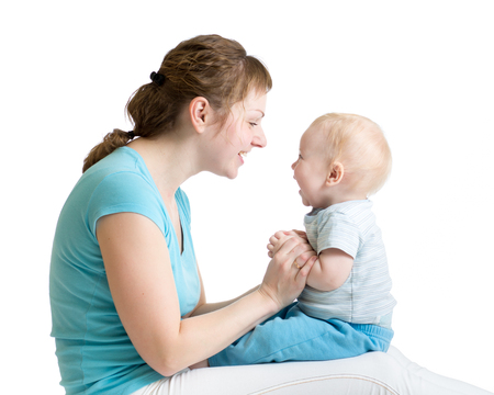 Portrait of mother and baby son laughing and playing photo