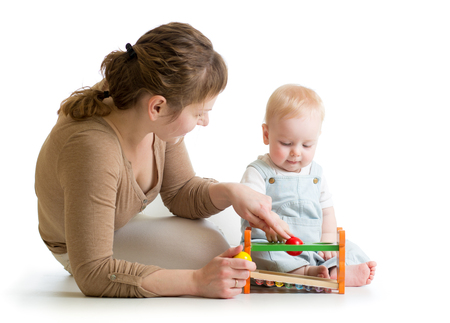 baby boy and mother playing together with logical toy Stock Photo