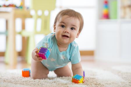 crawling baby boy on living room floor, happy child